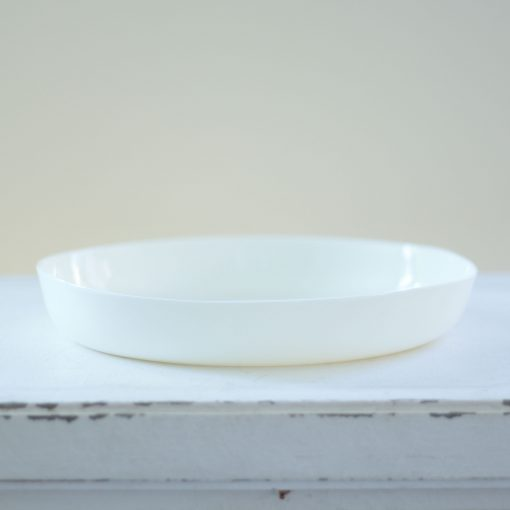 Modern serving bowl made from Limoges porcelain, which is light but durable and dishwasher safe, in a simple minimalist shape and a range of colours.